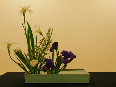 Ikebana showing water with iris as the main bloom.